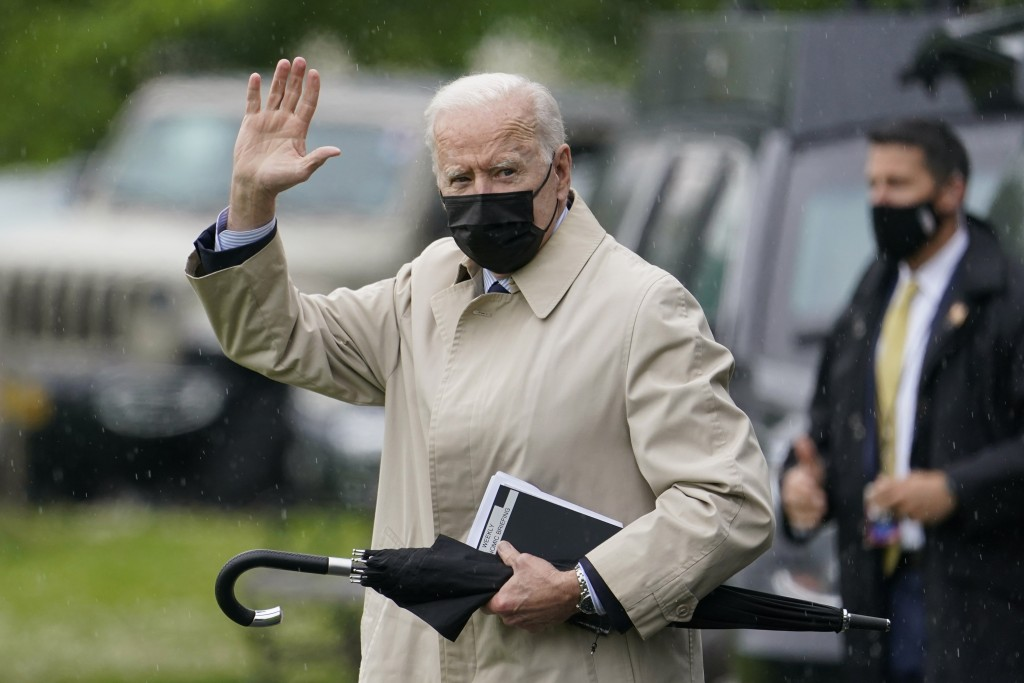 President Joe Biden waves as he walks to Marine One on the Ellipse near the White House, Friday, May 7, 2021, in Washington. Biden is spending the wee...