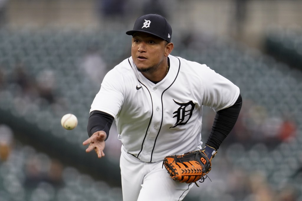 Detroit Tigers first baseman Miguel Cabrera tosses the ball to first base for an out against the Minnesota Twins in the third inning of a baseball gam...