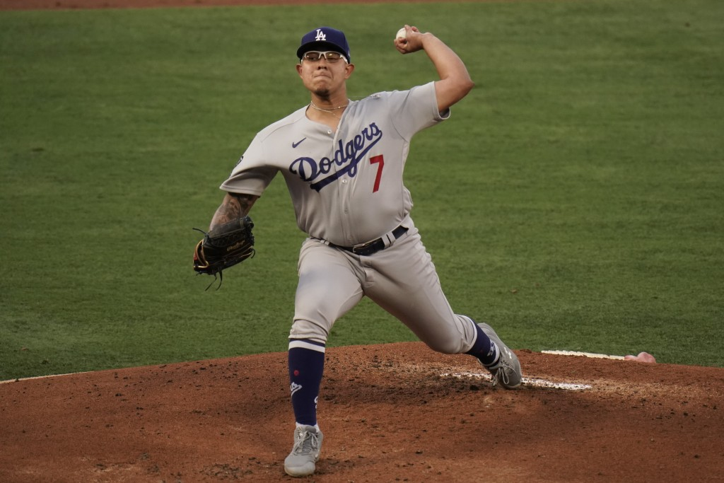 Los Angeles Dodgers starting pitcher Julio Urias throws against the Los Angeles Angels during the first inning of a baseball game, Friday, May 7, 2021...