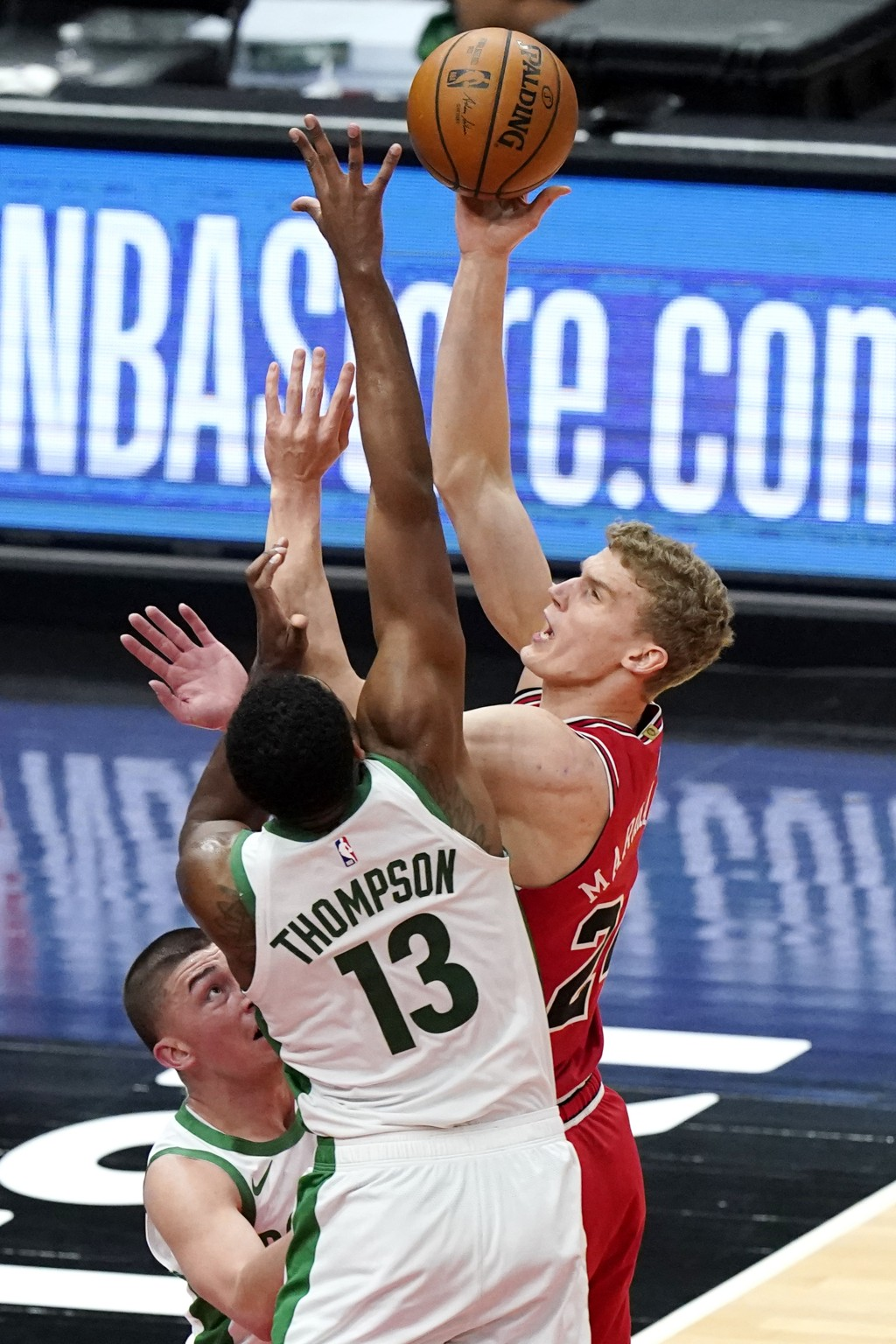 Chicago Bulls forward Lauri Markkanen, right, shoots against Boston Celtics guard Payton Pritchard and center Tristan Thompson (13) during the first h...