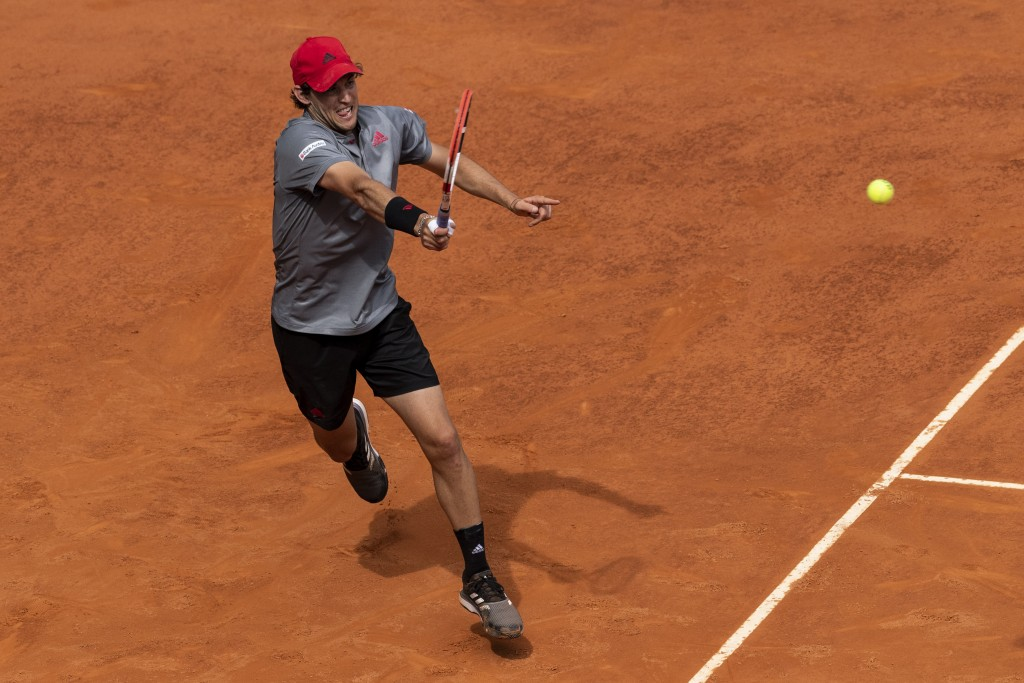 Austria's Dominic Thiem returns the ball to Germany's Alexander Zverev during their semi-final match at the Mutua Madrid Open tennis tournament in Mad...
