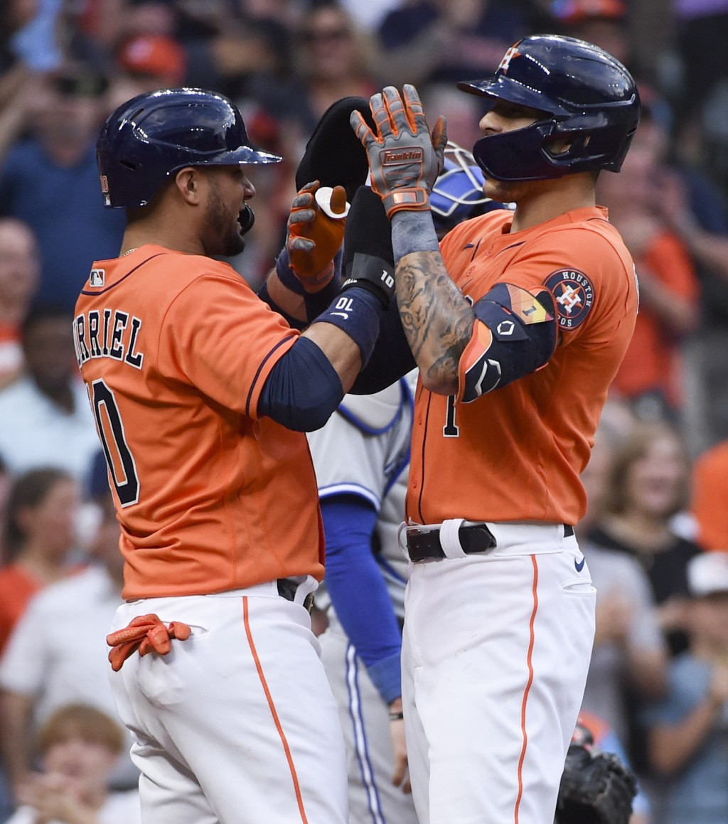 Houston Astros' Carlos Correa, right, celebrates his two-run home run with Yuli Gurriel during the second inning of baseball game against the Toronto ...