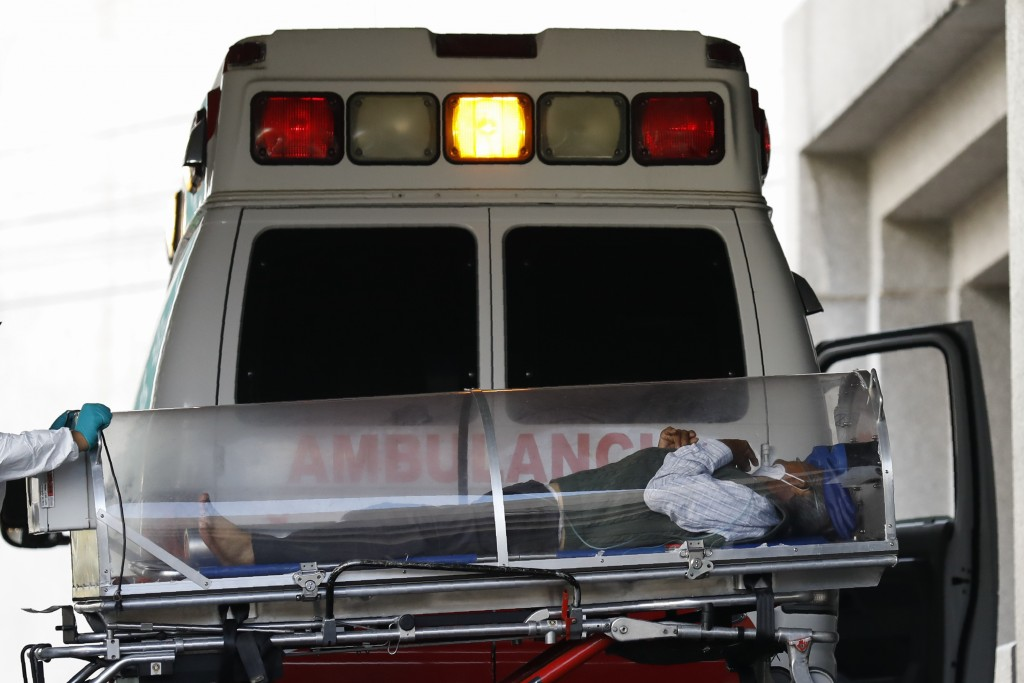 FILE - In this Jan. 10, 2021 file photo, a patient is moved from an ambulance into the COVID-19 treatment center at Dr. Carlos MacGregor Sanchez Gener...