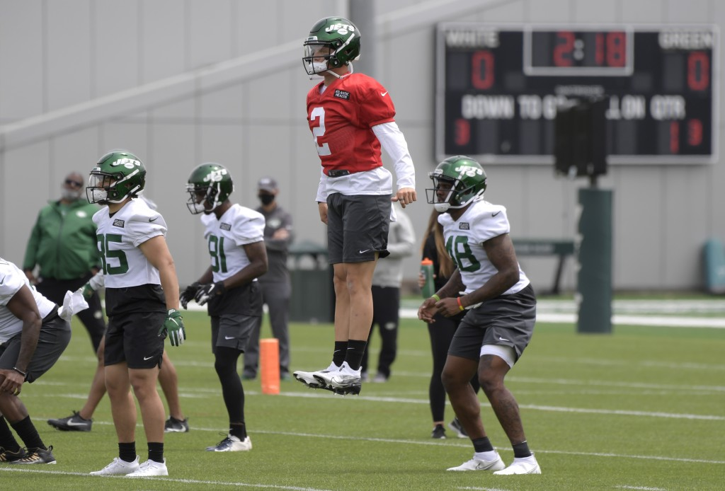 New York Jets first round draft pick Zach Wilson (2) works out during NFL football rookie camp, Friday, May 7, 2021, in Florham Park, N.J.(AP Photo/Bi...