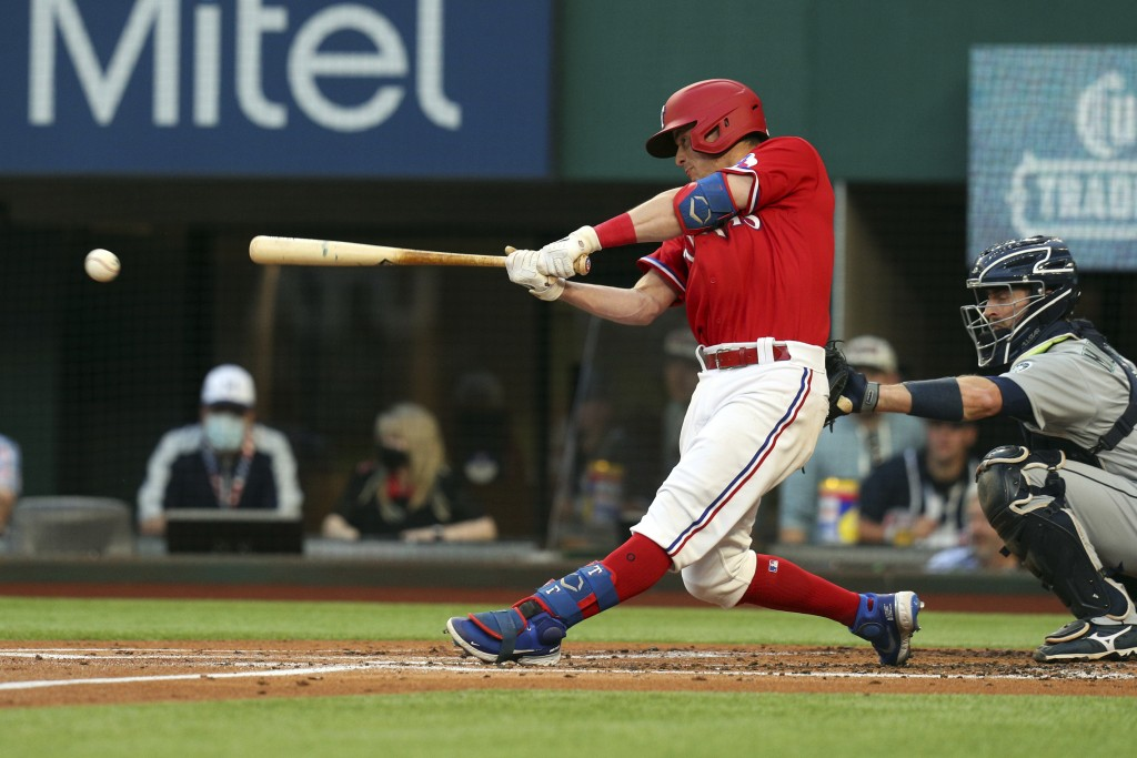 Texas Rangers Nick Solak connects for an RBI single during the first inning against the Seattle Mariners in a baseball game Friday, May 7, 2021, in Ar...