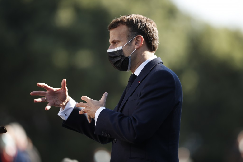 French President Emmanuel Macron speaks with the media as he arrives for an EU summit at the Crystal Palace in Porto, Portugal, Saturday, May 8, 2021....