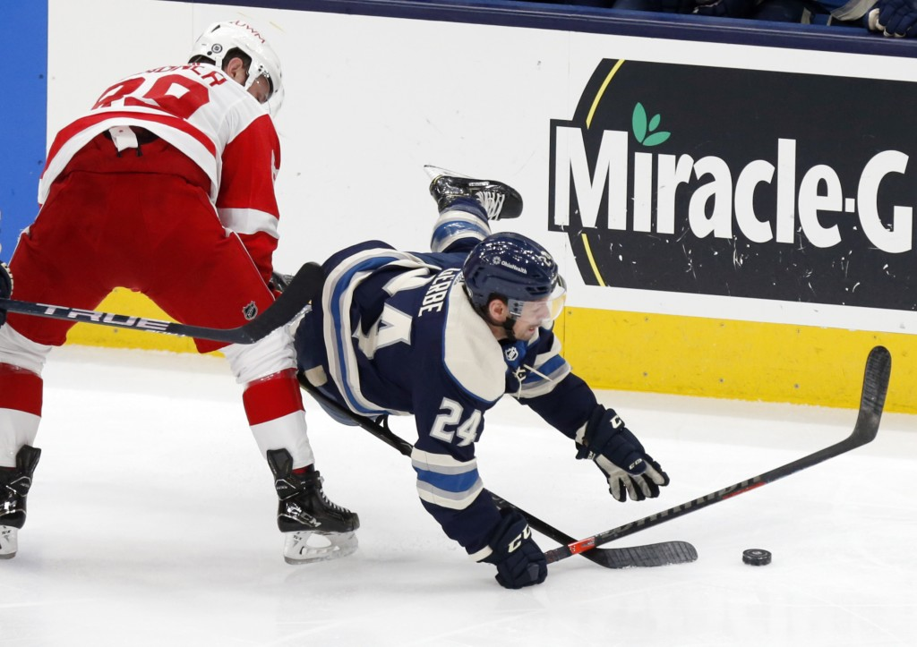 Columbus Blue Jackets forward Nathan Gerbe, right, falls in front of Detroit Red Wings forward Sam Gagner during the first period an NHL hockey game i...