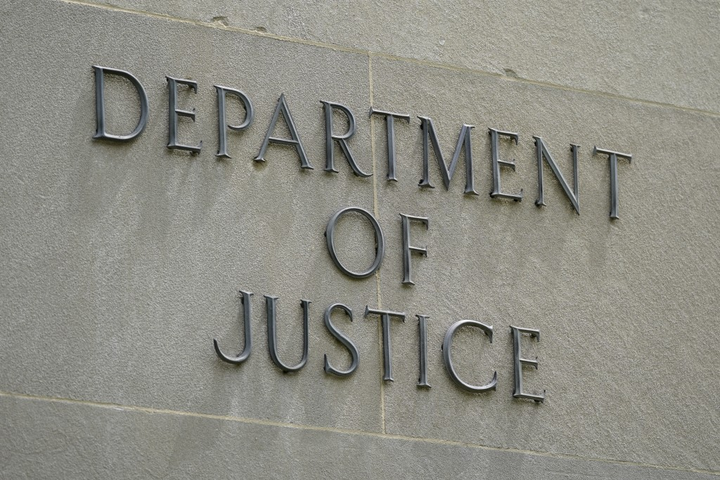 This May 4, 2021, photo shows a sign outside the Robert F. Kennedy Department of Justice building in Washington. The Trump Justice Department secretly...