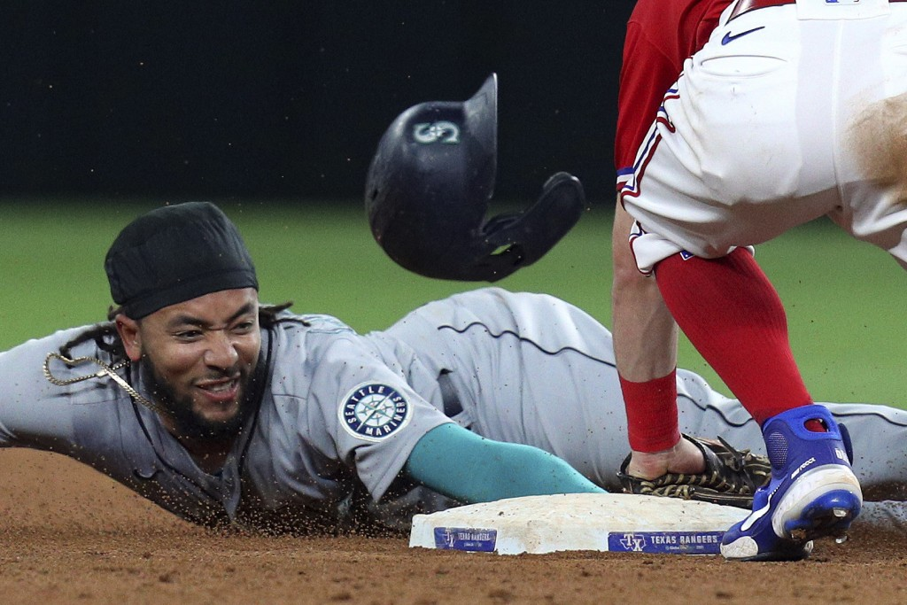 Seattle Mariners' J.P. Crawford is tagged out at second by Texas Rangers second baseman Nick Solak on an attempted steal during the sixth inning of a ...