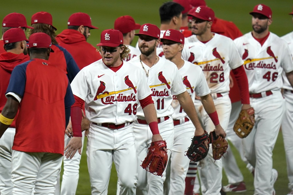 St. Louis Cardinals' Harrison Bader (48) celebrates with teammates following a 5-0 victory over the Colorado Rockies in a baseball game Friday, May 7,...