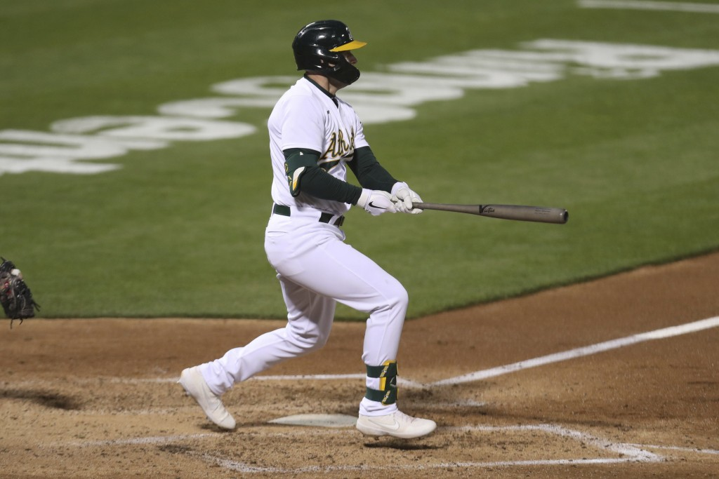 Oakland Athletics' Seth Brown watches his RBI single against the Tampa Bay Rays during the seventh inning of a baseball game in Oakland, Calif., Frida...