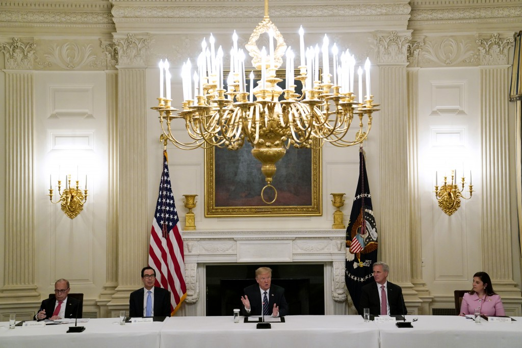 FILE - In this May 8, 2020, file photo President Donald Trump, center, speaks during a meeting with Republican lawmakers, in the State Dining Room of ...