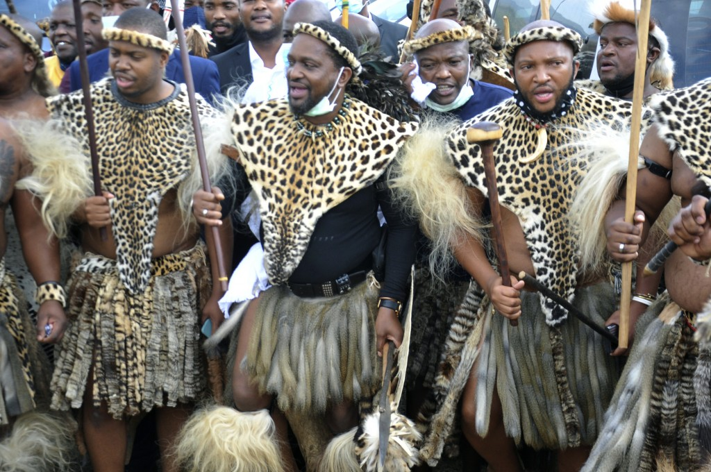 Prince Misuzulu Zulu, centre, flanked by fellow warriors in traditional dress at the KwaKhangelamankengane Royal Palace, during a ceremony, in Nongoma...