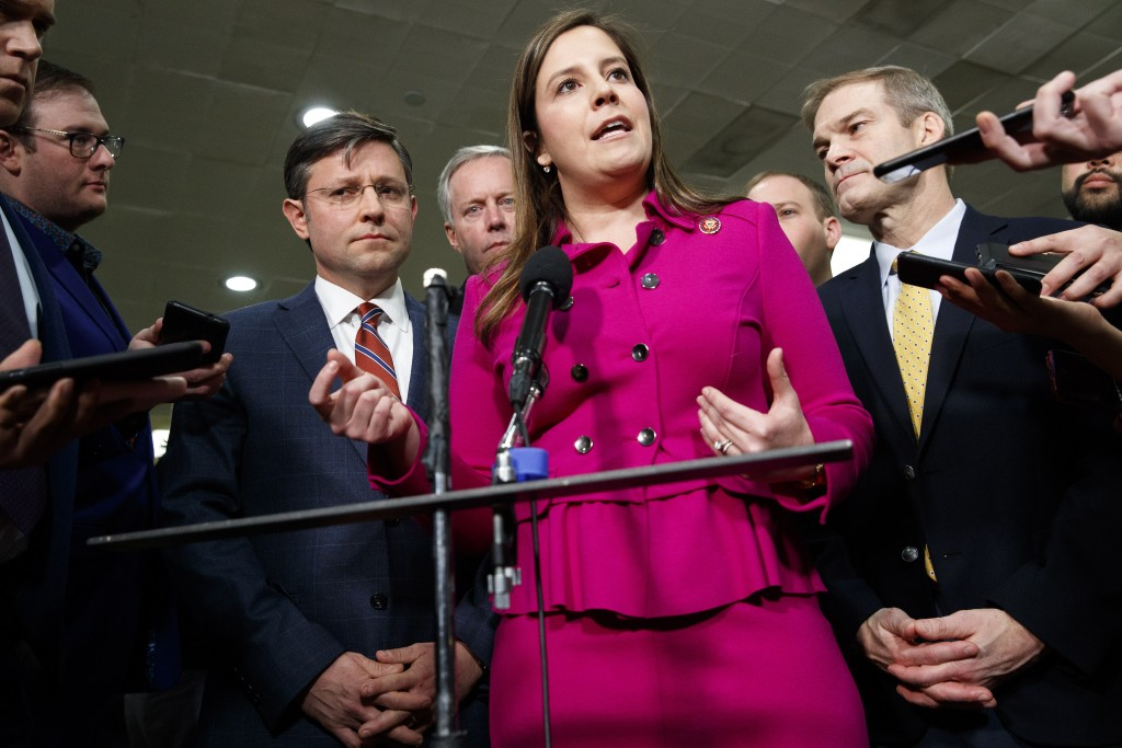 FILE - In this Jan. 23, 2020, file photo Rep. Elise Stefanik, R-N.Y., center, accompanied by from left, Rep. Mike Johnson, R-La., Rep. Mark Meadows, R...