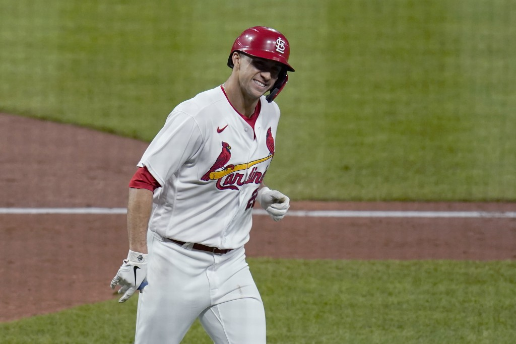 St. Louis Cardinals' Jack Flaherty smiles after hitting a solo home run during the third inning of a baseball game against the Colorado Rockies Friday...