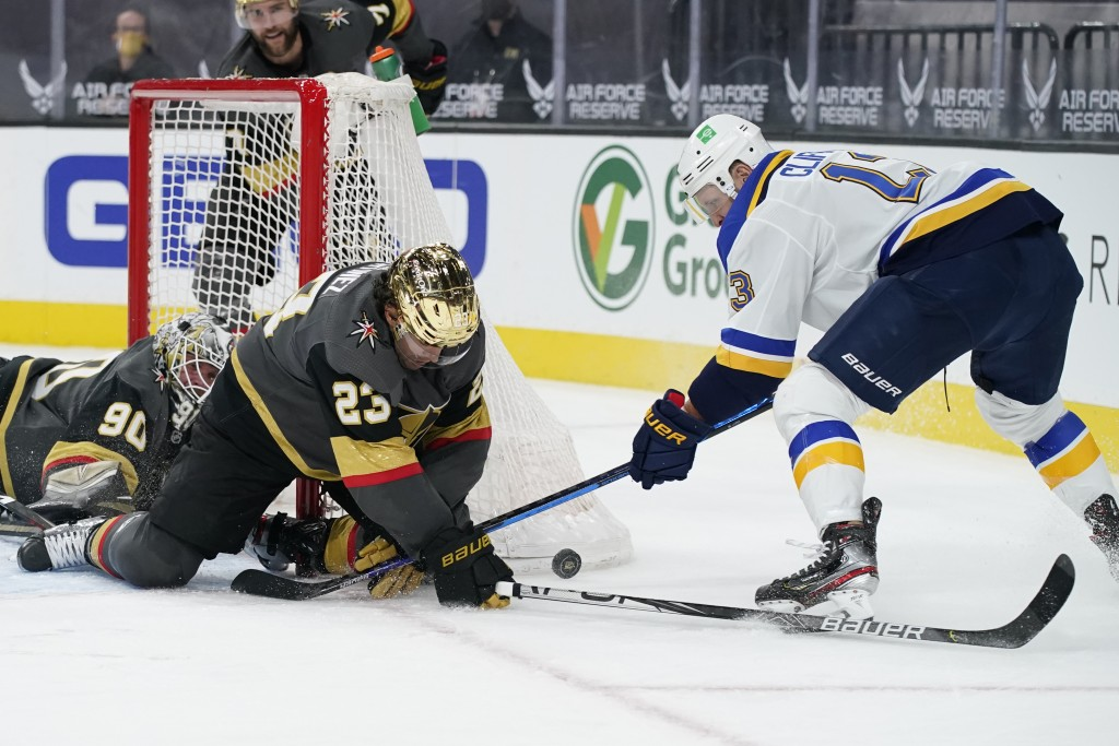 Vegas Golden Knights defenseman Alec Martinez (23) stops an attempted shot by St. Louis Blues left wing Kyle Clifford (13) during the third period of ...