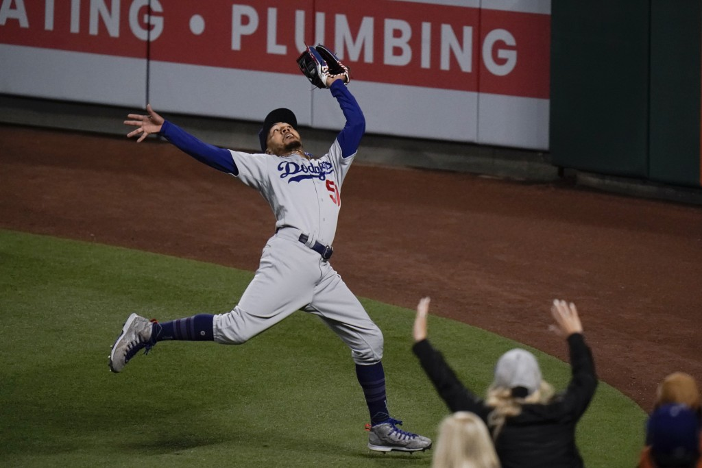 Los Angeles Dodgers' Mookie Betts catches a fly ball hit by Los Angeles Angels' Taylor Ward during the fourth inning of a baseball game, Friday, May 7...