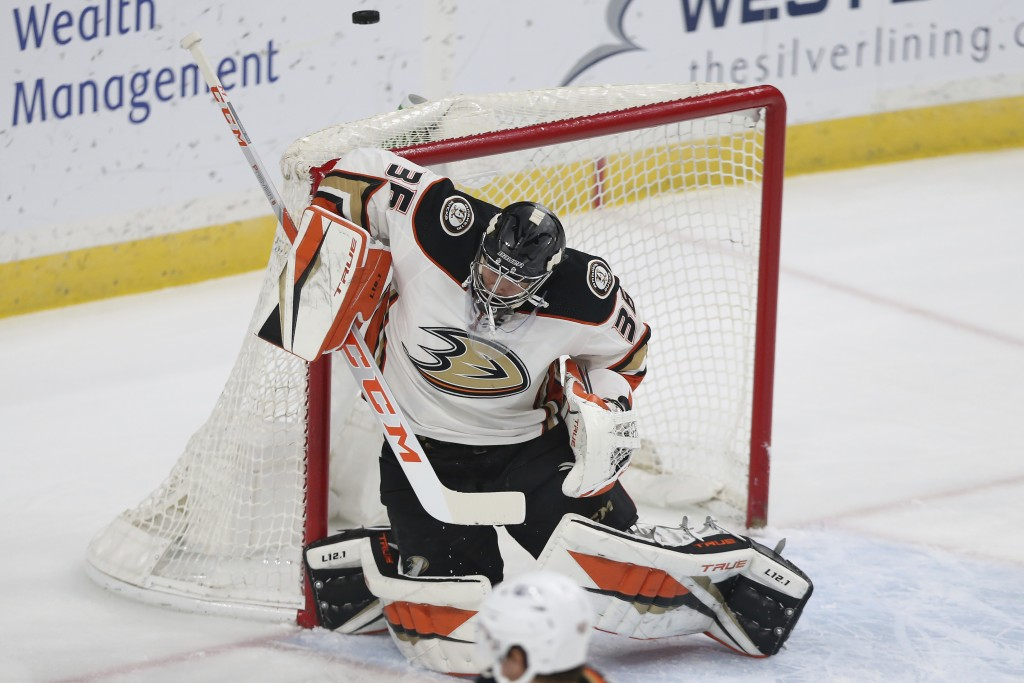Anaheim Ducks' goalie John Gibson (36) blocks the puck from the net against the Minnesota Wild during the first period of an NHL hockey game Friday, M...