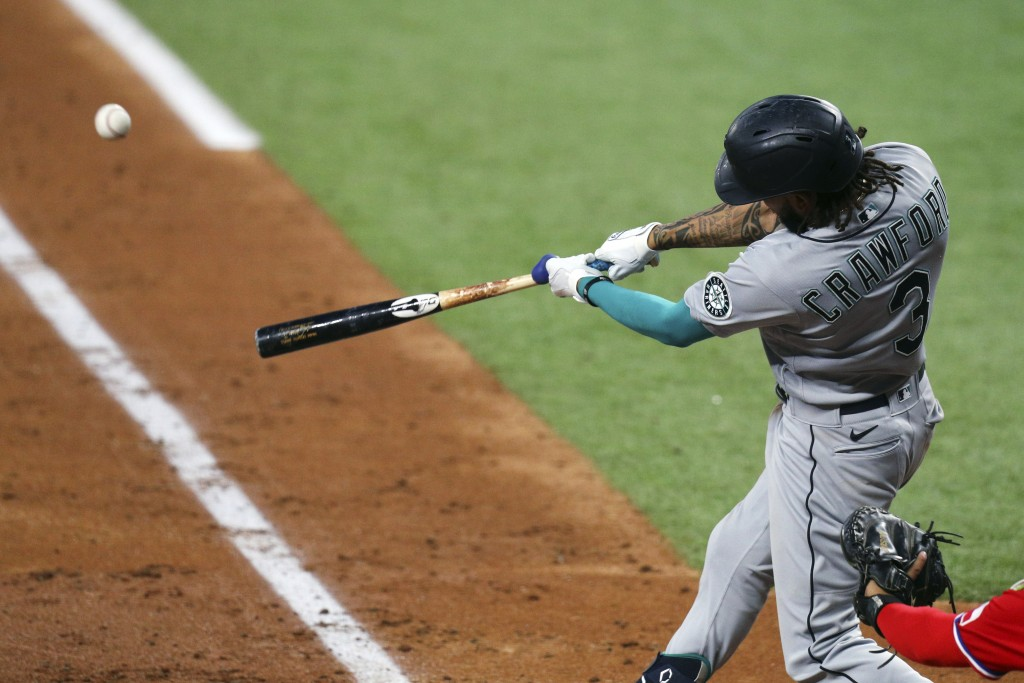 Seattle Mariners J.P. Crawford hits a two-run home run during the fourth inning against the Texas Rangers in a baseball game Friday, May 7, 2021, in A...