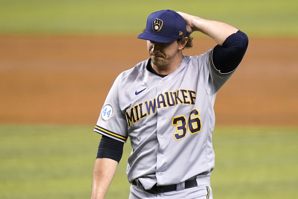 Milwaukee Brewers' Patrick Weigel (36) walks to the dugout during the third inning of a baseball game against the Miami Marlins, Friday, May 7, 2021, ...