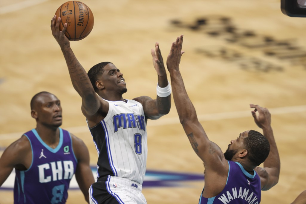 Orlando Magic guard Dwayne Bacon (8) shoots over Charlotte Hornets guard Brad Wanamaker during the second half of an NBA basketball game in Charlotte,...