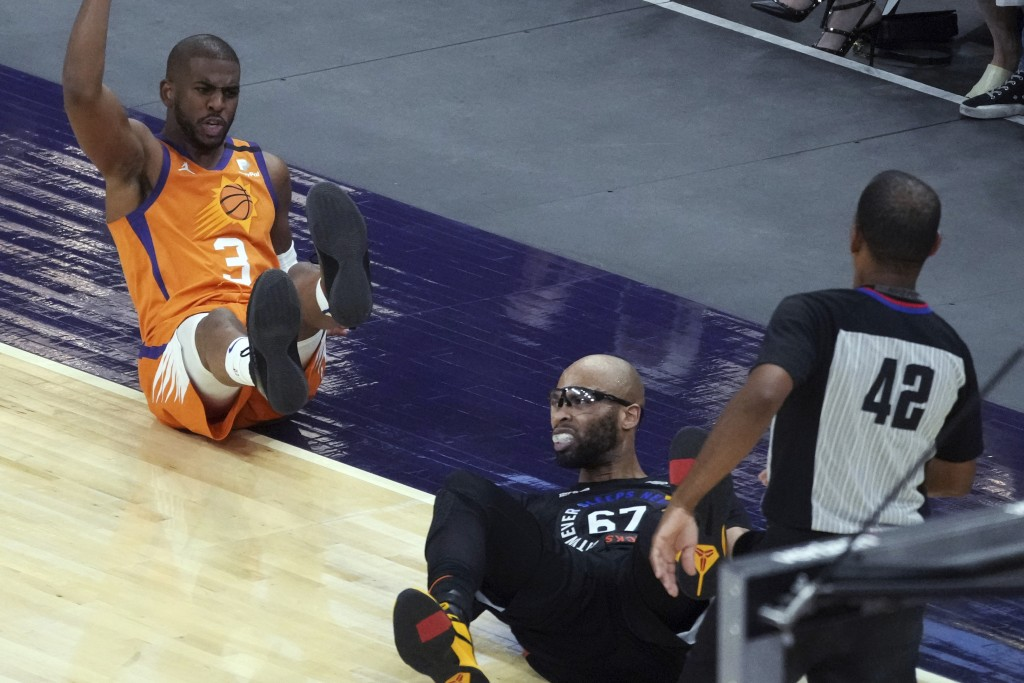 Phoenix Suns guard Chris Paul (3) reacts after getting knocked to the floor by New York Knicks center Taj Gibson (67) during the second half of an NBA...