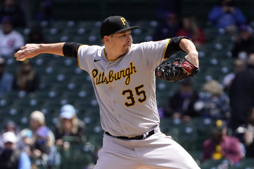 Pittsburgh Pirates starting pitcher Trevor Cahill delivers during the first inning of a baseball game against the Chicago Cubs Friday, May 7, 2021, in...