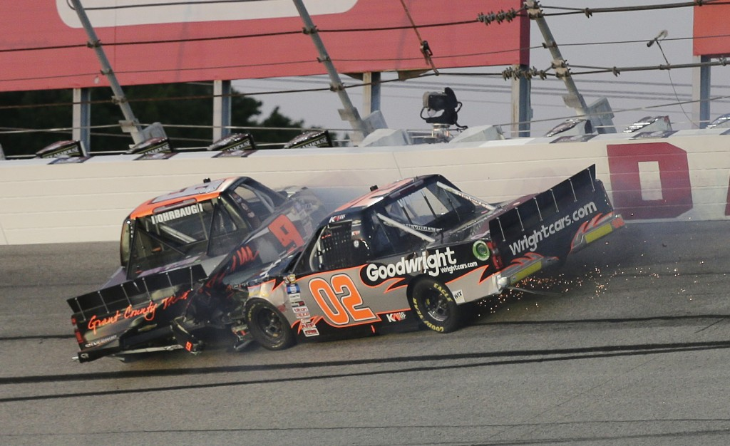 Kris Wright (02) and Codie Rohrbaugh (9) crash in Turn 2 during the NASCAR Truck Series auto race at Darlington Raceway, Friday, May 7, 2021, in Darli...