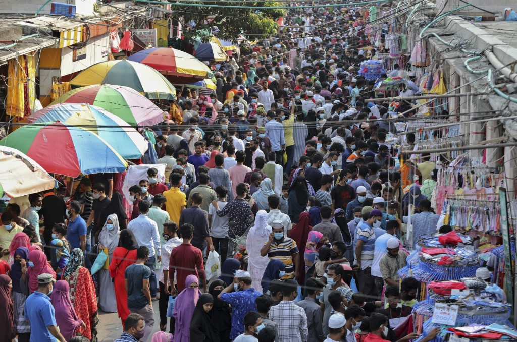 Shoppers crowd at a marketplace in Dhaka, Bangladesh, Friday, May 7, 2021. India's surge in coronavirus cases is having a dangerous effect on neighbor...