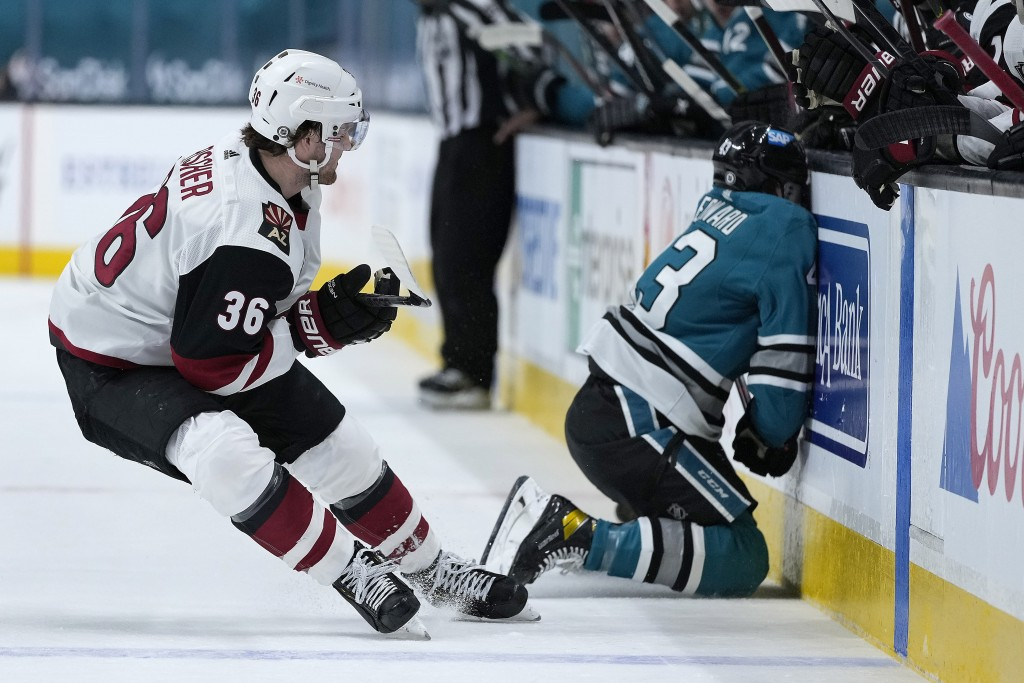 San Jose Sharks left wing John Leonard (43) collides against the boards as Arizona Coyotes right wing Christian Fischer (36) watches during the first ...