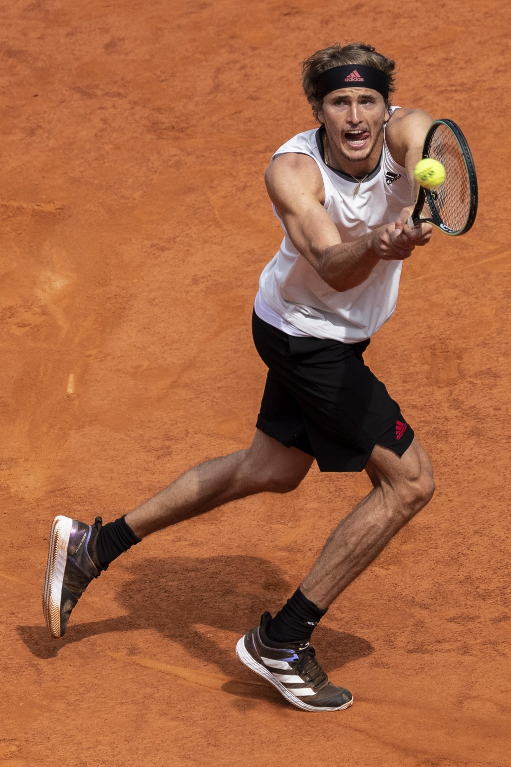 Germany's Alexander Zverev returns the ball to Austria's Dominic Thiem during their semi-final match at the Mutua Madrid Open tennis tournament in Mad...