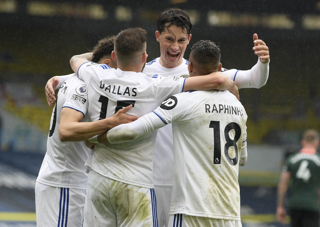 Leeds United's Rodrigo,left, is congratulated by teammates after scoring his team's third goal during the English Premier League soccer match between ...
