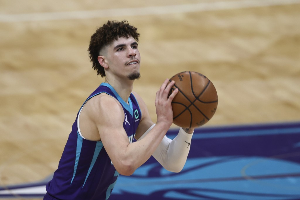 Charlotte Hornets guard LaMelo Ball shoots against the Orlando Magic during the first half of an NBA basketball game in Charlotte, N.C., Friday, May 7...