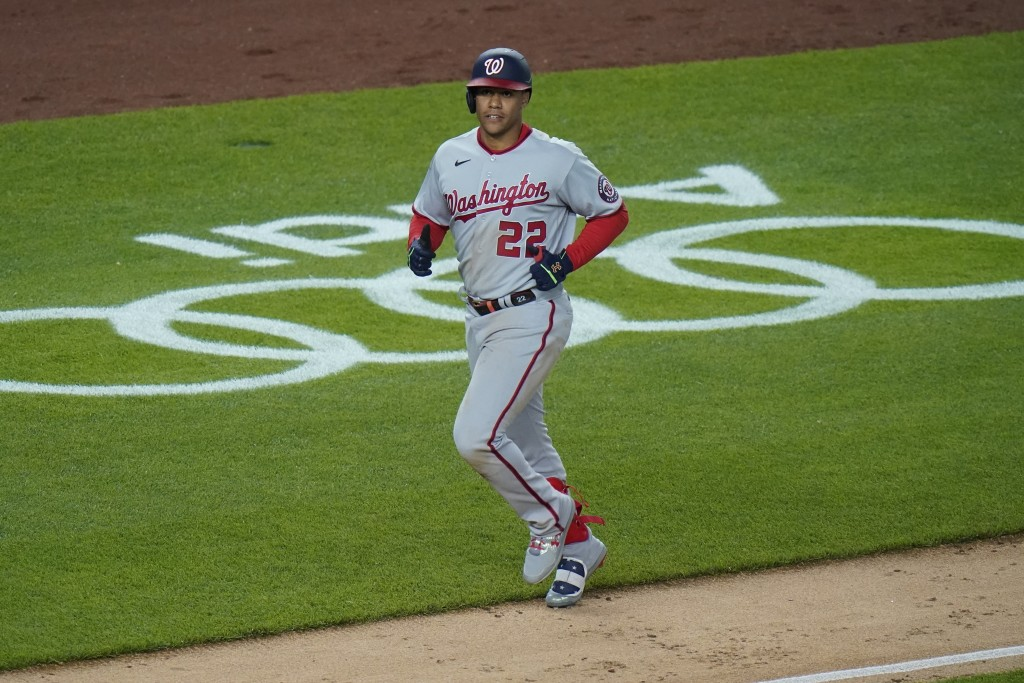 Washington Nationals' Juan Soto (22) runs the bases after hitting a two-run home run during the ninth inning of a baseball game against the New York Y...