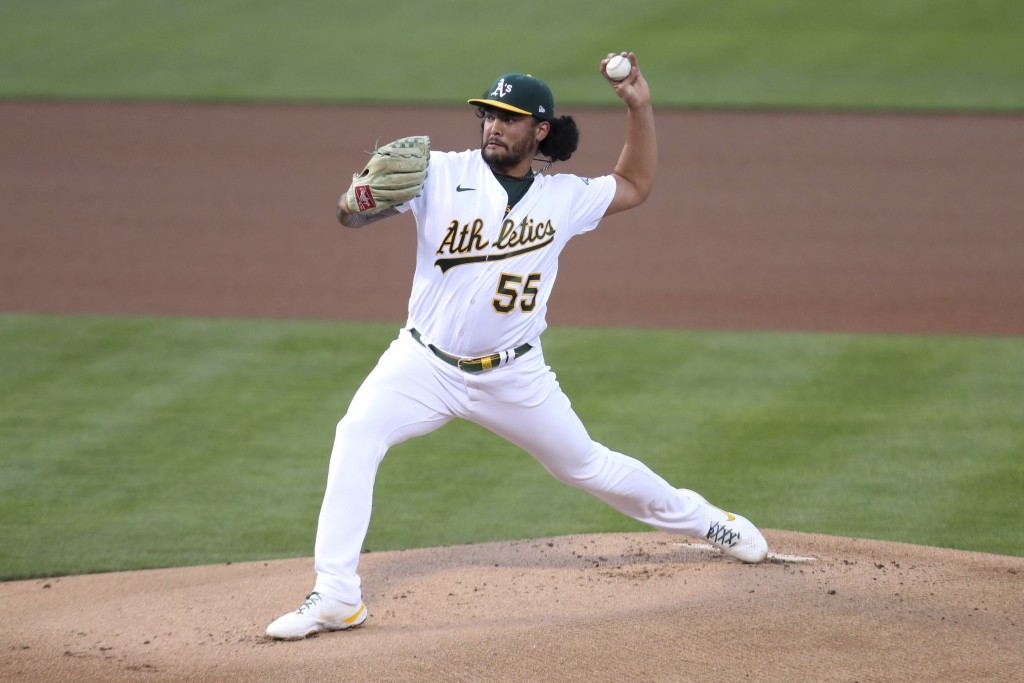 Oakland Athletics' Sean Manaea throws to a Tampa Bay Rays batter during the first inning of a baseball game in Oakland, Calif., Friday, May 7, 2021. (...