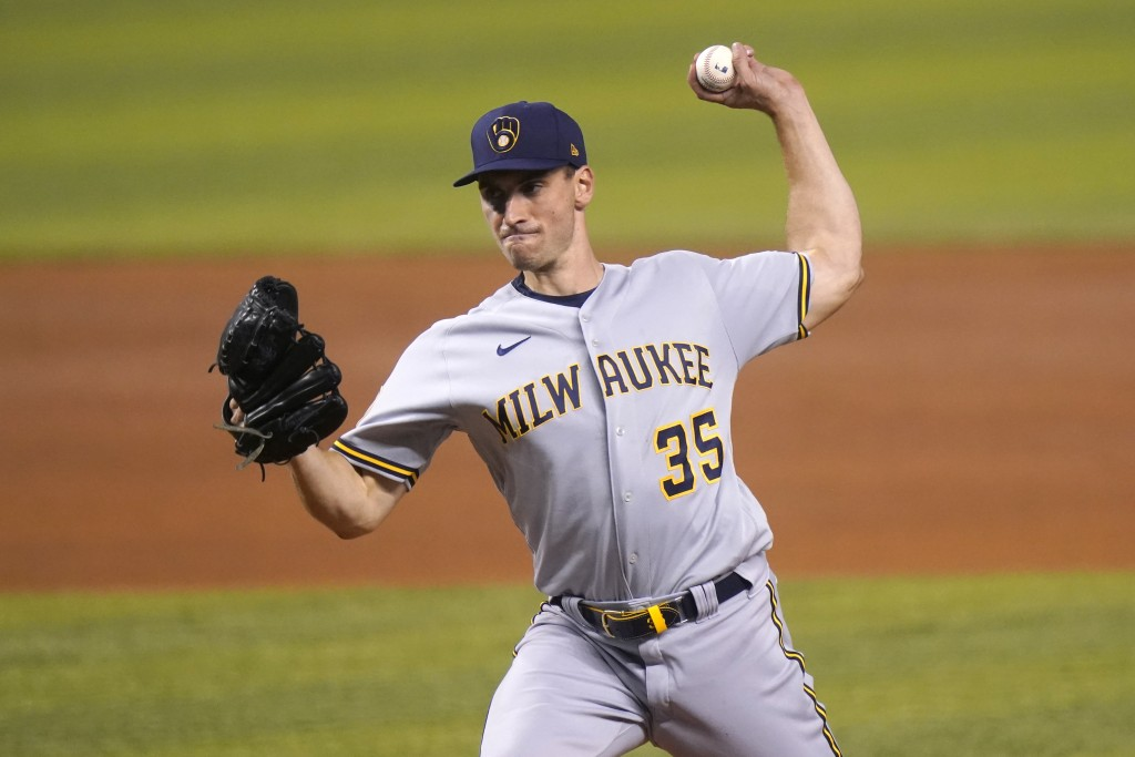Milwaukee Brewers starting pitcher Brent Suter throws during the first inning of the team's baseball game against the Miami Marlins, Friday, May 7, 20...