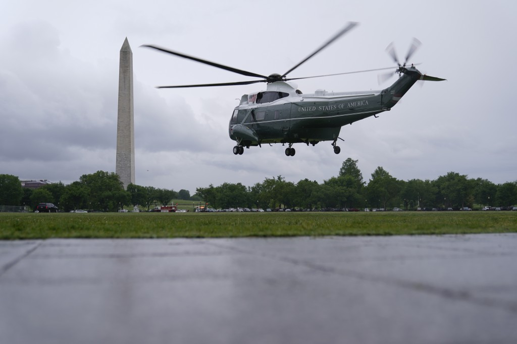 Marine One, with President Joe Biden aboard, lifts off from the Ellipse near the White House, Friday, May 7, 2021, in Washington. Biden is spending th...