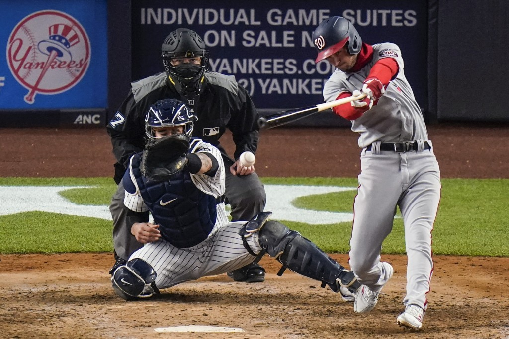 Washington Nationals' Trea Turner hits an RBI single during the eighth inning of the team's baseball game against the New York Yankees on Friday, May ...
