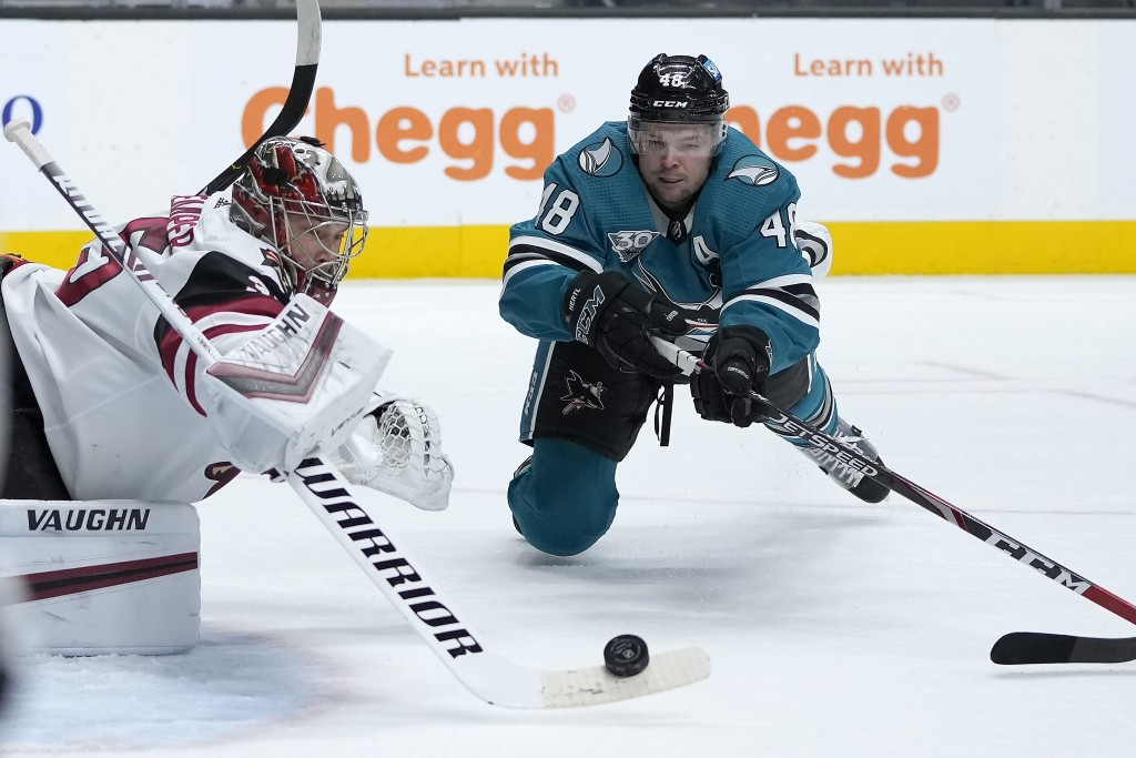 Arizona Coyotes goaltender Darcy Kuemper (35) blocks a goal attempt by San Jose Sharks center Tomas Hertl (48) during the first period of an NHL hocke...