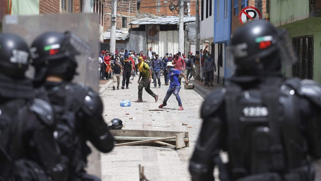 Anti-government protesters clash with police in Gachancipa, Colombia, Friday, May 7, 2021. The protests that began last week over a tax reform proposa...