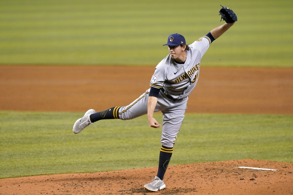 Milwaukee Brewers relief pitcher Patrick Weigel follows through on a delivery during the third inning of a baseball game, Friday, May 7, 2021, in Miam...