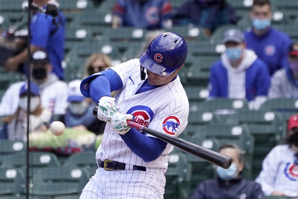 Chicago Cubs' Joc Pederson swings for an RBI single off Pittsburgh Pirates starting pitcher Trevor Cahill in the second inning of a baseball game Frid...