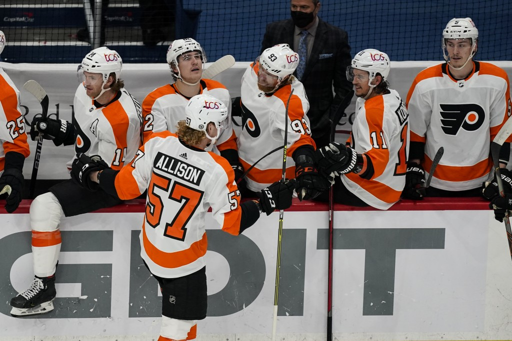 Philadelphia Flyers right wing Wade Allison (57) celebrates his goal with his teammates during the second period of an NHL hockey game against the Was...
