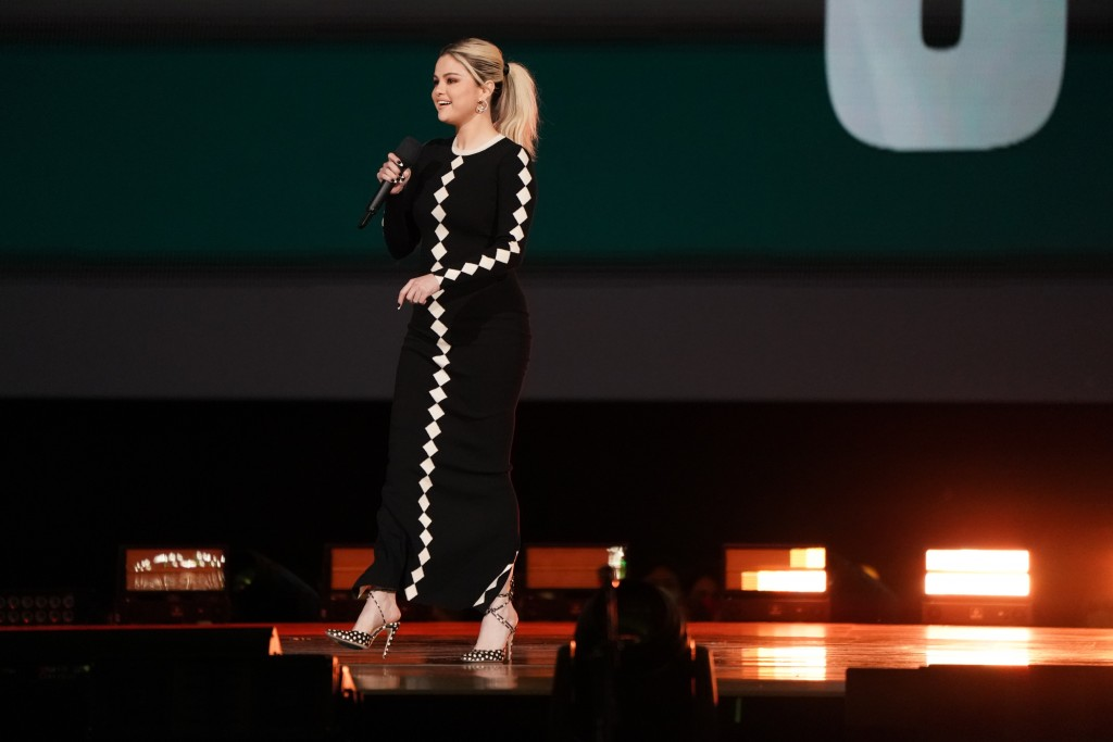 """Host Selena Gomez speaks during """"Vax Live: The Concert to Reunite the World"""" on Sunday, May 2, 2021, at SoFi Stadium in Inglewood, Calif. (Photo by Jo..."""