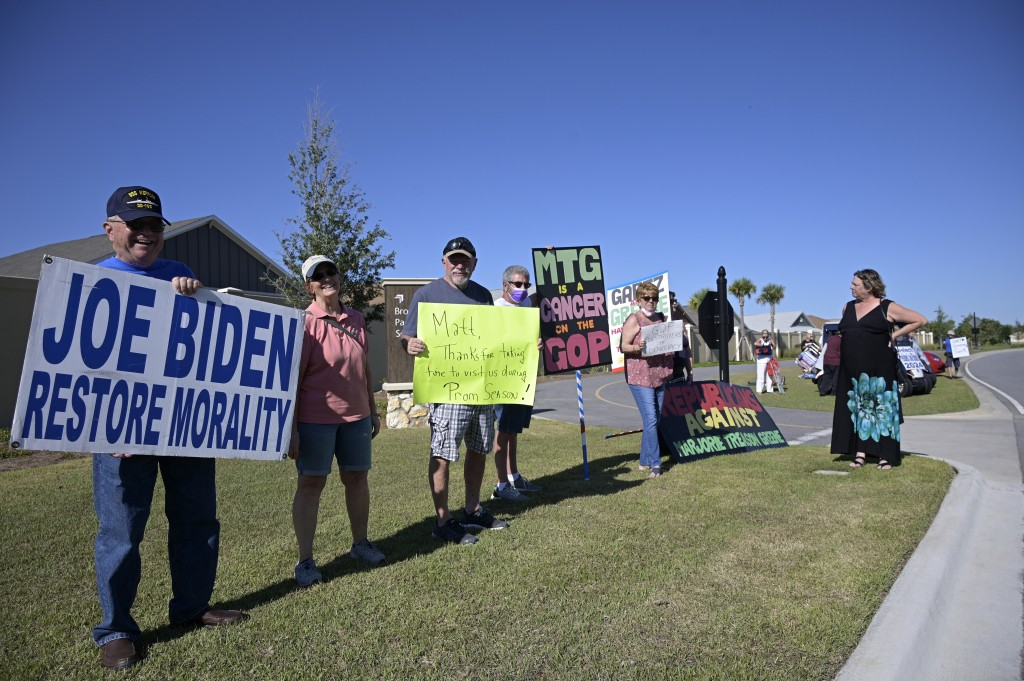 Protesters gather outside a rally featuring Rep. Matt Gaetz, R-Fla. and Rep. Marjorie Taylor Greene, R-Ga., Friday, May 7, 2021, in The Villages, Fla....