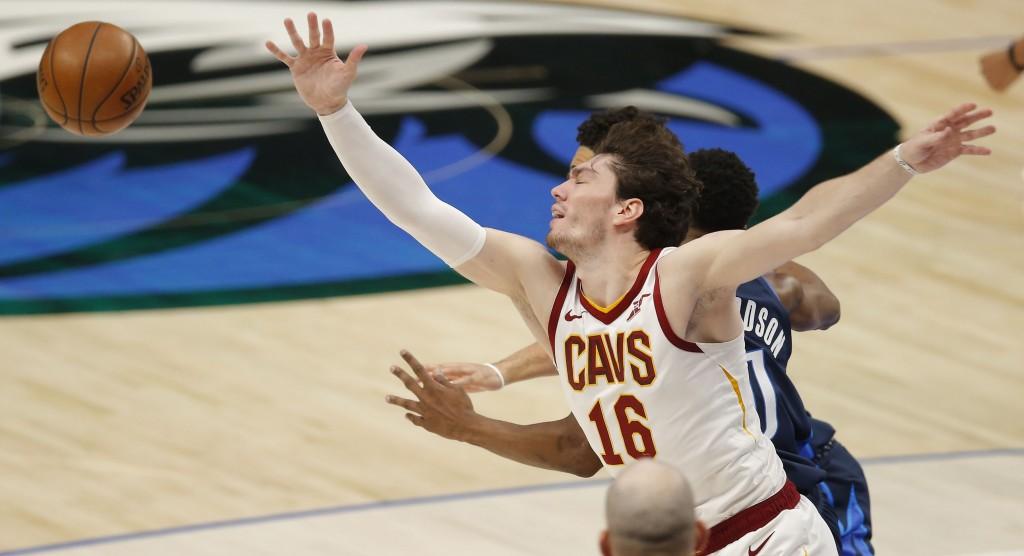 Cleveland Cavaliers forward Cedi Osman (16) reaches for the ball against Dallas Mavericks guard Josh Richardson (0) during the first half of an NBA ba...