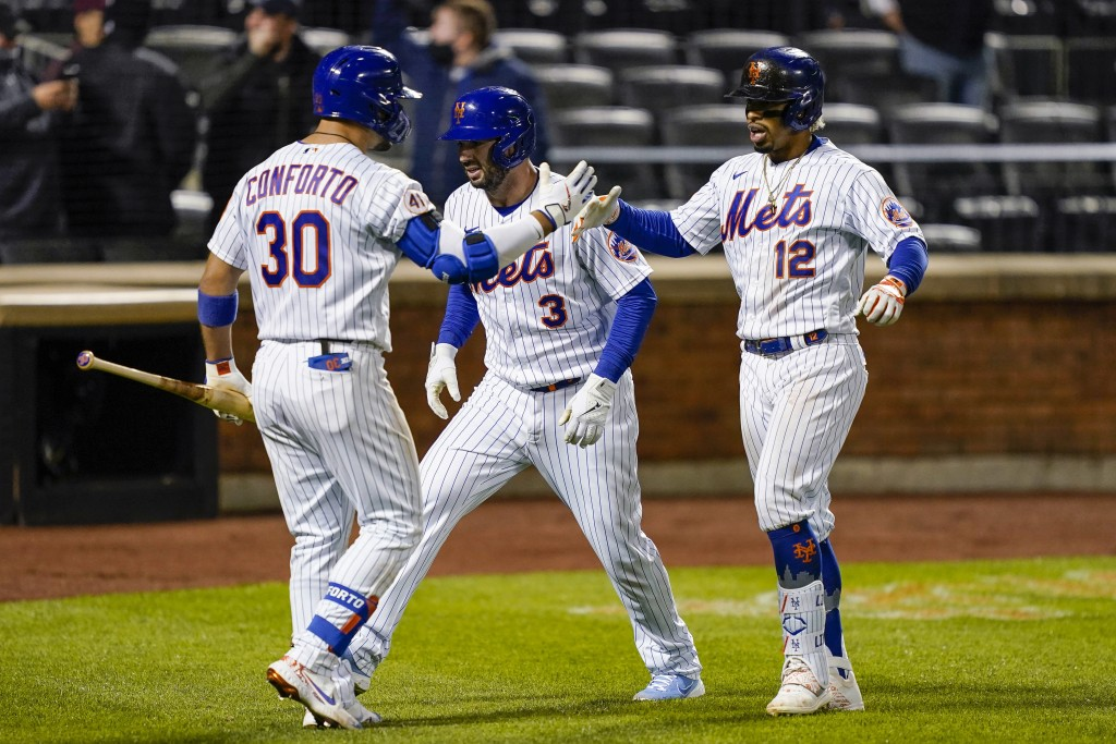 New York Mets' Francisco Lindor (12) celebrates with Tomas Nido (3) and Michael Conforto (30) after hitting a two-run home run off Arizona Diamondback...