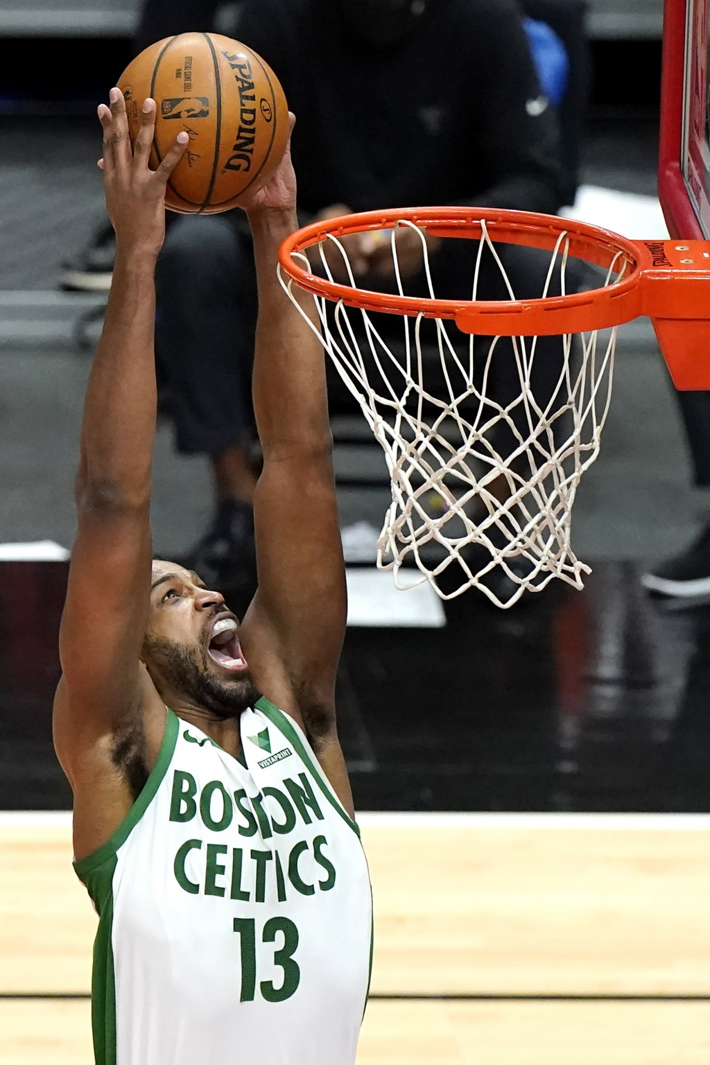 Boston Celtics center Tristan Thompson dunks against the Chicago Bulls during the first half of an NBA basketball game in Chicago, Friday, May 7, 2021...