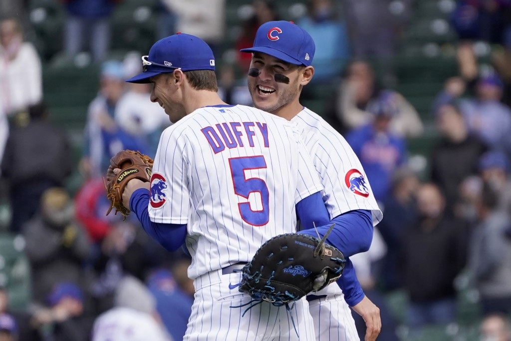 Chicago Cubs' Matt Duffy (5) and Anthony Rizzo celebrate their win over the Pittsburgh Pirates after a baseball game Friday, May 7, 2021, in Chicago. ...