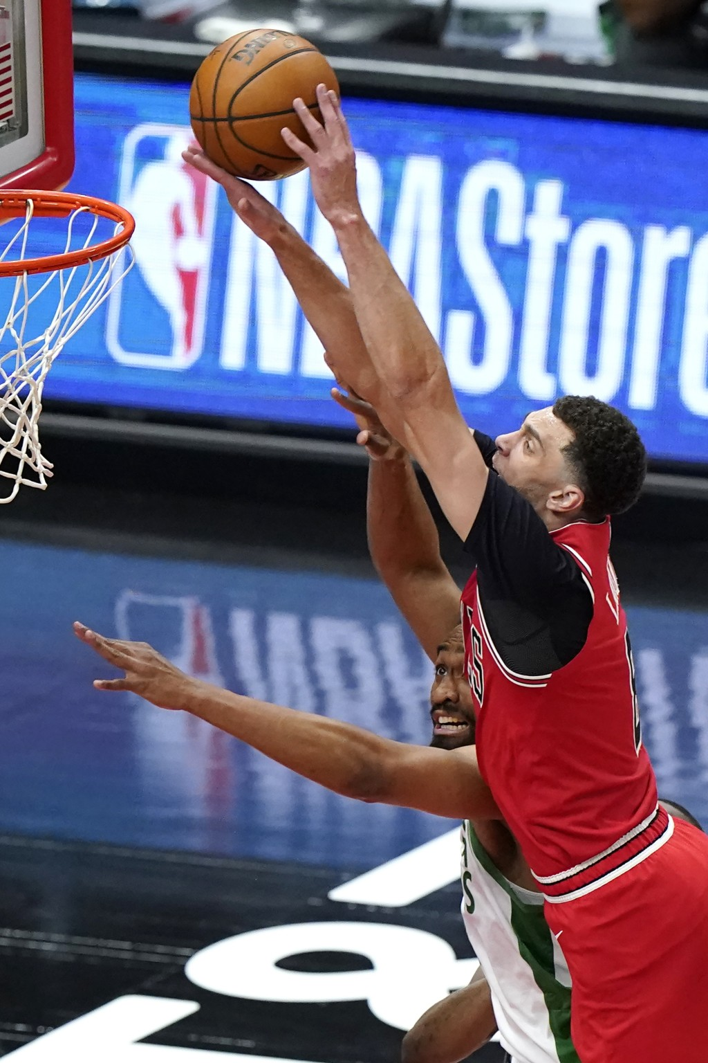 Chicago Bulls guard Zach LaVine, right, shoots against Boston Celtics forward Jabari Parker during the first half of an NBA basketball game in Chicago...